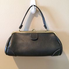 Black Vintage Handbag Darling black handbag.  EUC.  Single strap.  Kiss lock closure.  Scratches around clasp/gold colored trim.  11x3.5x6.  This bag is a classic that never goes out of style! Bags