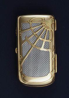 Cigarette Case  House of Carl Fabergé   Maker: Workmaster: Mikhail Evlampievich Perkhin (Russian, 1860–1903) Date: 1896–1903 Culture: Russian (Saint Petersburg) Medium: Silver, gold, enamel