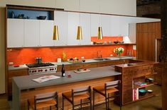 bright-red-backsplash and the built-in corner cabinet in the island