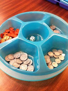 This game is VERY simple but powerful for the kids  because it helps them to make those connections that 5 pennies = 1 nickel,  2 nickels = 1 dime, etc... Dollar Tree chip container!