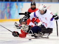 15 March Sochi 2014 Paralympic Games - Ice Sledge Hockey Bronze Medal Match Marc Dorion of Canada and Jan Roger Klakegg of Norway battle for the puck during the ice sledge hockey bronze medal game between Canada and Norway