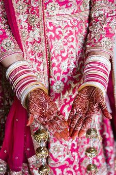 Revina + Shaminder - Stylish Punjabi Wedding in Sydney - Wedding day style - wedding chura - wedding bangles - henna - mehendi - kalire - Indian bride - Indian groom - Indian wedding - Sikh wedding - Sikh bride - Sikh groom - Punjabi wedding - Punjabi bride - Punjabi groom - hot pink wedding anarkali - heavy wedding anarkali. Read more at www.thecrimsonbride.com! #thecrimsonbride