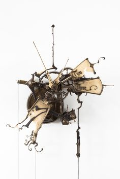 """Mechanical No.5"", 2008. 11"" x 12"" x 6"" (not including pendulum or weight)."