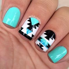 This tribal nail design is so fresh! It's especially powerful when paired with a fierce contrast nail polish like this beautiful turquoise.