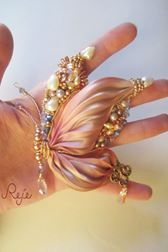 Bead embroidery and shibori silk butterfly by Reje, handmade in Italy www.rejesoutache.com  https://www.facebook.com/rejegioielliinsoutache