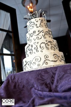 White & silver wedding cake with a bling cake topper!