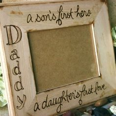 """Wood frame for Dad! Rustic large frame with custom saying for your Father from a son and daughter. Great Father's Day gift or birthday gift! So sweet for any dad. Hand engraved saying on a LARGE frame measures approx 9"""" x 12"""" with a 5""""x7"""" opening. You can choose the saying listed above """"Daddy, a son's first hero, a daughter's first love"""" OR send a saying that you want engraved! When checking out please include the following in the 'note..."""