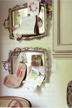 antique metal trays on the wall as magnet board. cute for the kitchen!