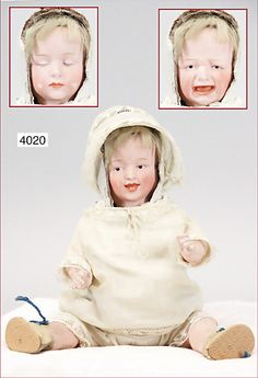 biscuit porcelain doll with three faces, 28 cm, Intaglio eyes, opened/closed mouth, crying, sleeping, laughing, a bit color is wear down at the cheeks is caused by the turn mechanism, standing mass body with jointed arms and legs, old clothes