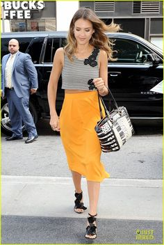 Jessica Alba in a Houghton top, Osman skirt, Kotur sandals and a Christian Louboutin tote bag.