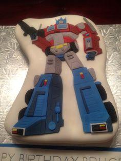 Bruce's birthday cake. Optimus Prime transformer cake. All parts handcut out of fondant. Raspberry vanilla bean cake!