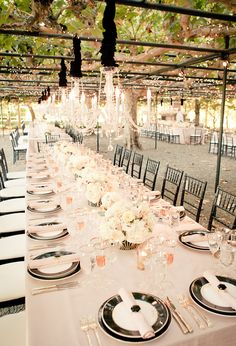 covered garden wedding reception with crystal chandeliers and black jewel accents