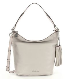 0d35c10da3be Wear it over the shoulder or crossbody! Bag converts from a shoulder bag to  a crossbody by adding strap.