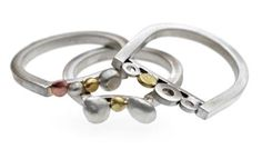 Combination pebble rings. Silver,18ct yellow and Rose gold.