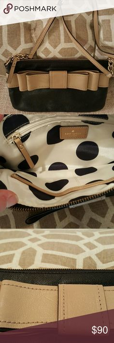 Kate Spade Crossbody Bowl Purse EUC black purse with tan bow. It has a 22 1/2 - 25 inch drop. There is an adjustable buckle. Approx  6 inch height and 11 inch length. Inside has one inner zip pocket and two open pockets. The only flaw I see is the indent on the bow which is barely noticeable, shown in picture. kate spade Bags Crossbody Bags