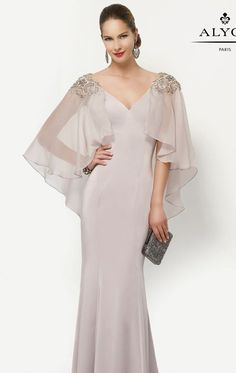 Look like a glamorous goddess in Alyce Jean De Lys 27170. Wide V-neckline with beaded lace adorn the shoulders and trim the low V-back. Flutter sleeves made of chiffon fabric drape over the back creating a stylish look.