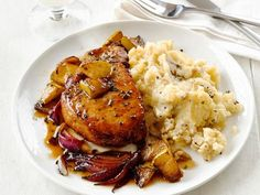 Get Pork Chops With Apples and Garlic Smashed Potatoes Recipe from Food Network