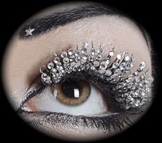 My guess is that you apply the crystals to a set of false eyelashes and then apply them carefully...