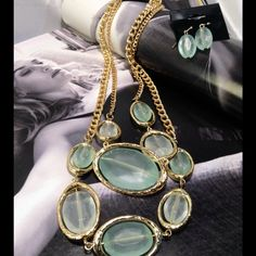 Mint Colored Necklace Set Simply gorgeous double strand on gold tone base. Measures 17 inches long with a 3 inch extender. Earrings are just a lil less than one inch long. (This closet does not trade or use Paypal) Jewelry Necklaces
