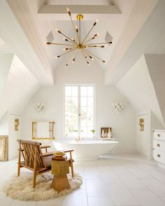 the light and ceiling make this attic bathroom a place I'd never want to leave! | photo michael wells