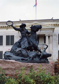 'Crossing the Red', is located in Altus, Oklahoma. The statue commemerates the life and work of drovers who herded cattle over the Great Western Trail from Texas to and through Oklahoma to Kansas, Colorado, Nebraska and points northwest - specifically the dangerous crossing with herds through the Red River a few miles south of Altus at Doan's Crossing.