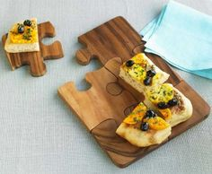 Wooden jigsaw puzzle board that can be used for serving or separate them for individual plates
