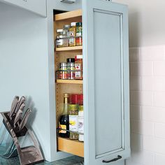 Pullouts flanking this range keep spices and cooking oils at hand. | Photo: Julian Wass | thisoldhouse.com