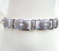 Beautifully handcrafted solid Sterling Silver link bracelet with Toggle clasp. Link bracelet is 8 inches long. There are 5 solid links that are 1 inch by 1/2 of an inch. Provided by Native American Navajo Silversmith 'T' -'Florence Tahe'. $158