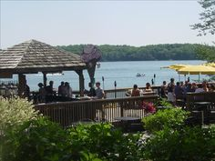 Barefoot Tiki Bar at Victorian Village Resort offers food, fun, and live music - all on deck overlooking Elkhart Lake.