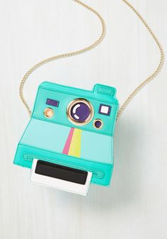 Vintage Bags Polaroid-style Lead a Charmed Ex-Insta Bag at ModCloth - We love this Lead a Charmed Ex-Insta Bag at ModCloth. Perhaps because we love Polaroid cameras! That's the obvious inspiration for this colourful bag. Cute Handbags, Handbags On Sale, Luxury Handbags, Purses And Handbags, Cheap Handbags, Popular Handbags, Luxury Bags, Luxury Purses, Gucci Handbags