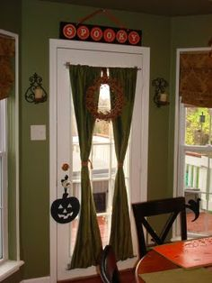 One of my next projects. Replace mini blinds on the back door with curtains.