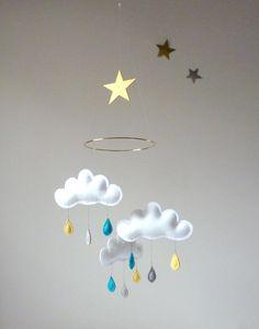 "Rain Cloud Mobile for Nursery ""MERLIN"" with gold  star. $59,00, via Etsy."