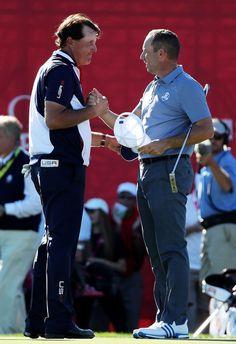 Sergio Garcia of Europe and Phil Mickelson of the United States react on the green after halving their match during singles matches of the 2016 Ryder Cup at Hazeltine National Golf Club on October 2016 in Chaska, Minnesota. Chaska Minnesota, Phil Mickelson, Ryder Cup, October 2, Golf Lessons, Golf Clubs, Masters, Legends, 18th