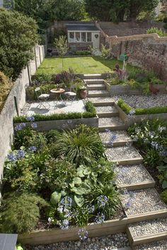 The garden features a carefully chosen colour palette, with a selection of pebbl. The garden features a carefully chosen colour palette, with a selection of pebbles, wood and Indian