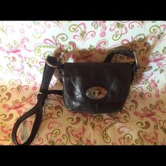 "Authentic Fossil Crossbody Purse Authentic Fossil Crossbody Purse. Black leather. Gently used. Turnlock latch/soft leather/small crossbody. Great for a night out when you do not want to carry a large bag!  Will hold your phone, keys, small wallet, etc.  Get it before it is gone!  Measures:  6"" X 8.5"" X 3"". The strap is 23"" and expands to 43"". Fossil Bags Crossbody Bags"