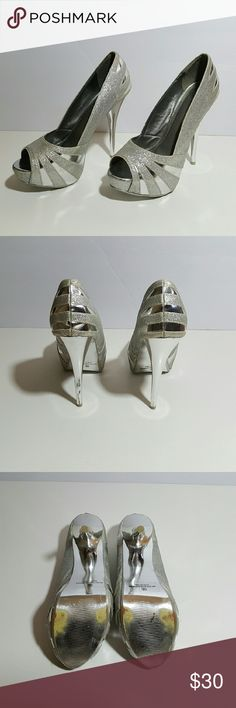 Sheihk Glitter Silver Open Toe Heels Size 9.5 Gently worn. Front of shoe has slight wedge and back is a stiletto heel.  Slight wear on the bottom (see pics).  Excellent condition!  Lots of glitter, SO much fun! Sheikh Shoes Heels