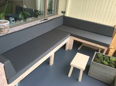 My own made bench with cushions on it