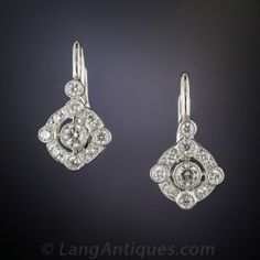 Inspired by a classic Art Deco design, these petite and precious ear drops sparkle with a central collet-set diamond floating inside a compass style frame. .44 carats total diamond weight. Newly made in gleaming 14K white gold, 5/8 by 3/8 inch with lever backs.