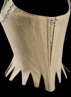 Stays 1780-1789 | Linen, hand sewn with linen thread, applied ribbon, chamois and whalebone | Museum number:T.172-1914 | V&A Search the Collections