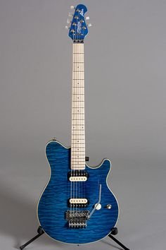 Sterling AX40...formerly the Eddie Van Halen sig model by Ernie Ball Music Man (and later Peavey and EVH) Pretty Sure Duddy B uses this