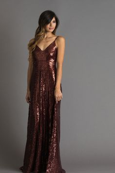 This sequin backless gown is absolutely stunning. The v-neckline and backless cut will have you turning heads all night long! We love this bold look for this holidays' special occasions! 100% Polyeste
