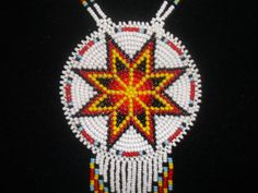 morningstar necklace approx. 2 3/4 dia approx. 28 necklace deer hide back with DC stamped on it. all hand made 100% native made