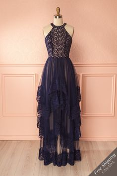 Jemma Navy #Boutique1861/ Appear like a Greek goddess in this ornate halter gown! The stretch beige lining creates a sweetheart neckline and ensures your comfort and coverage. The fine embroidered mesh creates swirls and vines, as though nature herself grew to veil you in glory. The layered asymmetrical skirt flows over your hips to the floor, making this piece unique and glamorous. An invisible zipper in back makes it easy to slip into. Add a gold cuff bracelet or armband and gilded laurel…