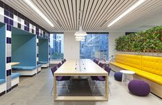 Wunderman / Bienalto Sydney Activity Based Workplace (ABW). Grafitti art by Beatman and Numskull. Reception / arrival / quiet booths. Polished concrete / white brick / tiles / banquette / slatted ceiling.
