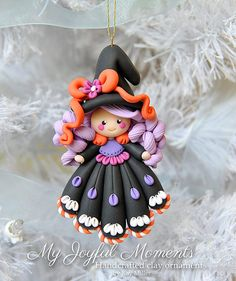 This is s one of a kind, handcrafted ornament made of durable polymer clay, with much attention given to detail and careful construction. No molds have been used, so you can be sure you are receiving a unique and one of a kind keepsake.    This ornaments measures approximately 2 1/4 inches wide by 3 3/4 inches tall not including the ribbon hanger. The item in the photo is the exact item you are purchasing and will receive.    This cute little witch ornament made with lots of love and…
