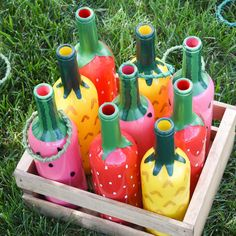 Fruit salad ring toss - wine bottle crafts - upcycled crafts - recycled crafts - outdoor game - game DIY - tailgate games - backyard games - outdoor party crafts upcycling Arts and Crafts Store Liquor Bottle Crafts, Wine Bottle Art, Painted Wine Bottles, Diy Bottle, Paint Bottles, Bottle Vase, Liquor Bottles, Glass Bottles, Upcycled Crafts