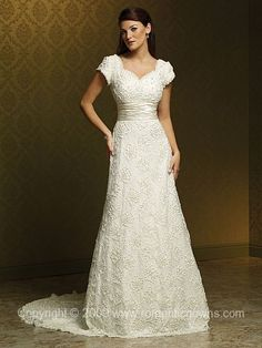 Excellent neckline on this dress. Romantic lace and a great chapel length train.