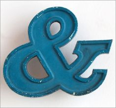 Vintage blue cast metal company sign ampersand '&' symbol