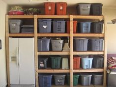 Built Garage Shelves; love the way the refrigerator is nestled in there & all the labeled storage bins neat & tidy!