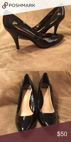 FERGALICIOUS WOMEN'S SYMPHONY PUMPS Only been worn once for a photoshoot. Price is negotiable.                                                     •Faux leather upper in a dress pump style with a pointed toe •Slip-on entry •Cupped heel •Smooth lining, cushioning insole •Traction outsole, 3 and 1/4 inch covered heel Fergie Shoes Heels